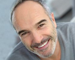 Man Smiling in Gray shirt | Davenport Dental Group | Laredo, TX